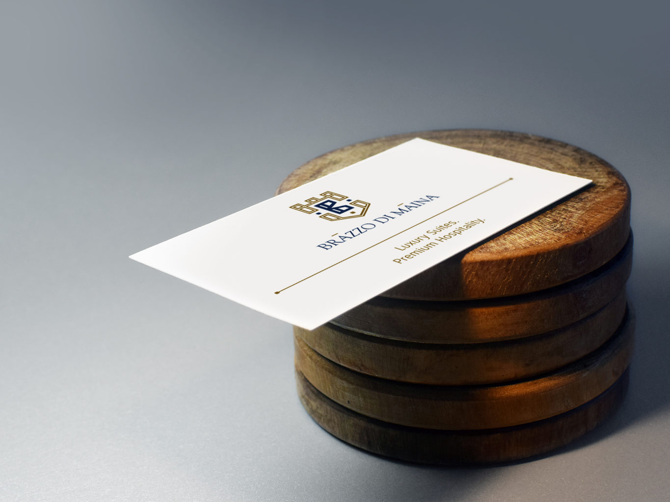 brazzo di maina business card on a wooden surface